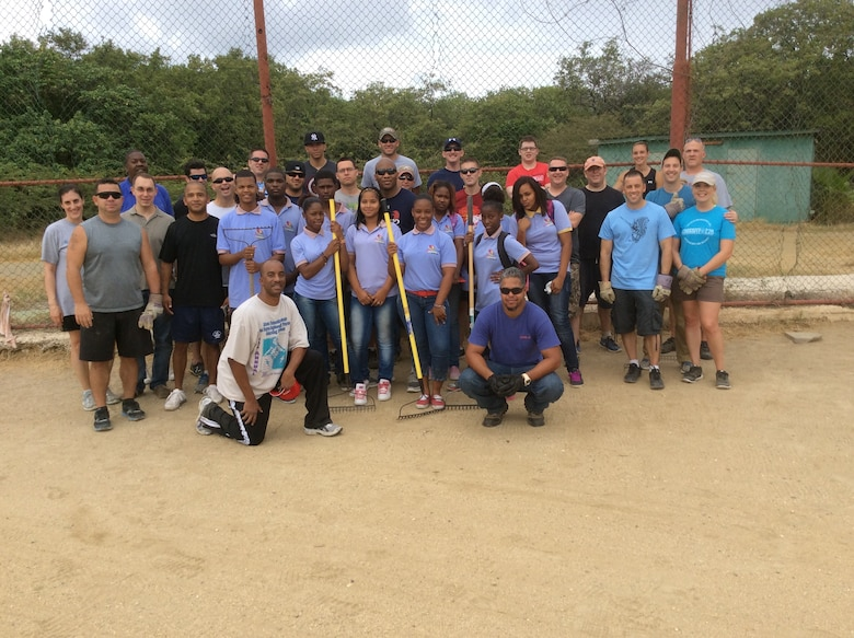 Over 50 volunteers from the U.S. Forward Operating Location cleaned the baseball field next to the Holiday Beach Hotel in Willemstad, Curacao, May 5, 2014.  US FOL volunteers, along with students from Goslinga School, spent several hours clearing debris, picking up trash, and cutting the overgrown tree branches and grass on the field.  Personnel from the US FOL often donate time and resources to various areas and programs on the island in order to express appreciation for the wonderful hospitality received from the citizens of Curacao.  The baseball field is used by Goslinga School and Saint Joseph School for recreation during school hours.  (Courtesy Photo)
