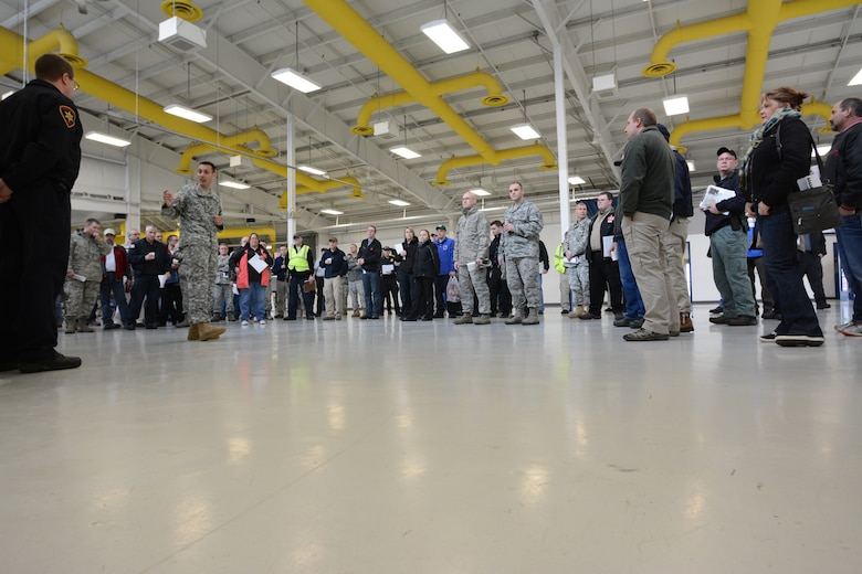 Participants of the 2014 State Interoperable Mobile Communications Exercise listen to their morning briefing at the Sunnyview Exposition Center in Oshkosh, Wis., May 15, 2014. More than 100 agencies from 34 communication platforms were in attendance. Members of the Wisconsin National Guard attended to test their ability to communicate with other agencies to ensure everything worked properly should an emergency situation arise. (Air National Guard photo by Senior Airman Andrea F. Liechti)