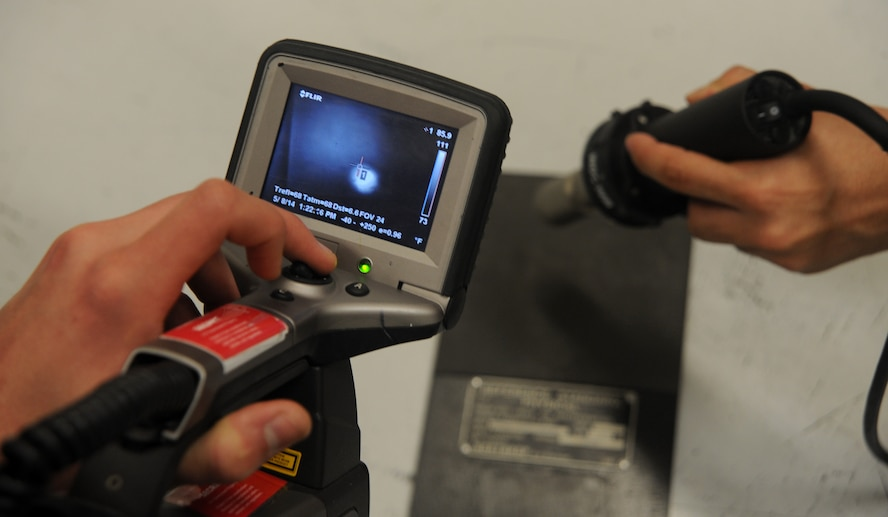 Airman Kawika Cadman, 509th Maintenance Squadron non-destructive inspection technician, uses infrared technology to find discrepancies in aircraft parts at Whiteman Air Force Base, Mo., May 8, 2014. Infrared thermography uses heat signatures to look for disbands and delaminates on the aircraft. (U.S. Air Force photo by Senior Airman Bryan Crane/Released)