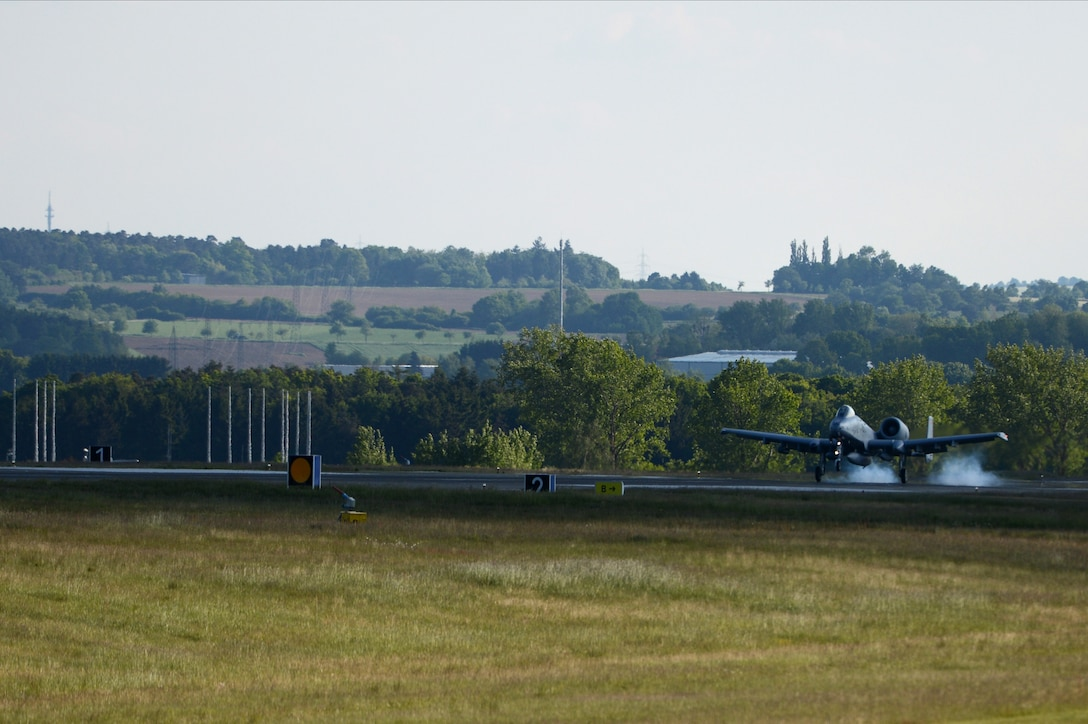 A U.S. Air Force A-10 Thunderbolt II attack aircraft pilot from the 190th Fighter Squadron lands on the flightline at Spangdahlem Air Base, Germany, May 16, 2014. Approximately 100 Air National Guard Airmen from Gowen Field, Idaho, accompanied the aircraft in support of exercise Combined Resolve II. The exercise uses the air power provided by the A-10s to assist ground forces from NATO allies with close-air-support procedures and operations. (U.S. Air Force photo by Senior Airman Gustavo Castillo/Released)