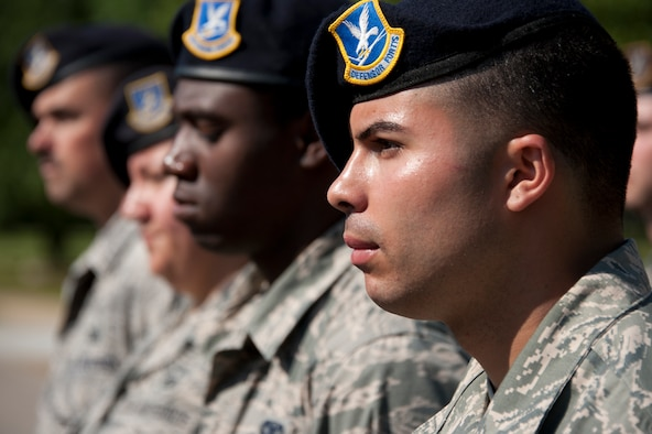 Staff Sgt. Eddie Sang, 42nd Security Forces Squadron, stands in formation during a National Police Week retreat ceremony here, May, 16, 2014. The ceremony included speeches from retired and active duty security forces members as well as a 21-gun salute. The squadron held events on base all week to pay tribute to law enforcement members who made the ultimate sacrifce in the line of duty.(U.S. Air Force photo by Staff Sgt. Natasha Stannard.)