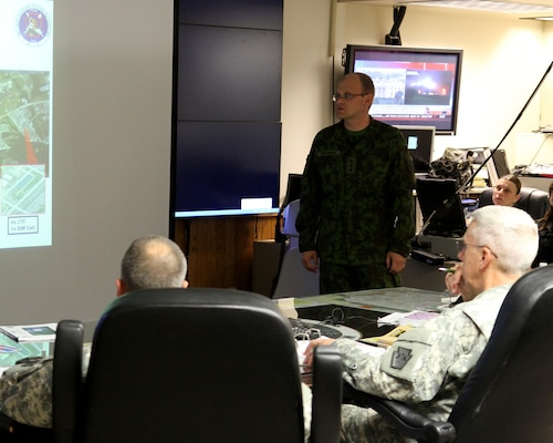 Capt. Vilius Berzanskas of the Lithuanian Army briefs Maj. Gen. Wesley Craig, Pennsylvania State adjutant general, during the morning update briefing for the Vigilant Guard training exercise in May, 2014.