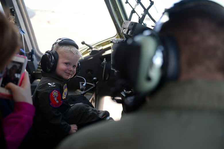 Two-year-old John Austin smiles as he listens to radio traffic inside the cockpit of a C-17 Globemaster III cargo aircraft May 15, 2014, at Altus Air Force Base, Oklahoma. John was diagnosed with acute lymphoblastic leukemia when he was four months old, but has been in remission since December 2011 and finished treatment in October 2013. (U.S. Air Force photo/Staff Sgt. Nathanael Callon)