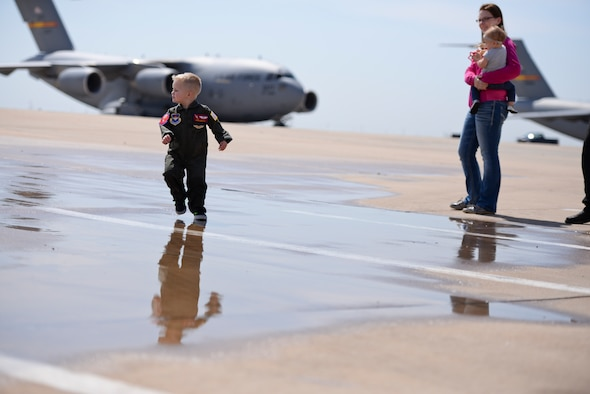 Two-year-old John Austin runs on the flightline during his Pilot for a Day visit May 15, 2014, at Altus Air Force Base, Okla. John was diagnosed with acute lymphoblastic leukemia when he was four months old, and his parents were told that he had a 45 percent chance of surviving to age 5. He has since completed treatment and has been in remission since December 2011. (U.S. Air Force photo/Staff Sgt. Nathanael Callon)