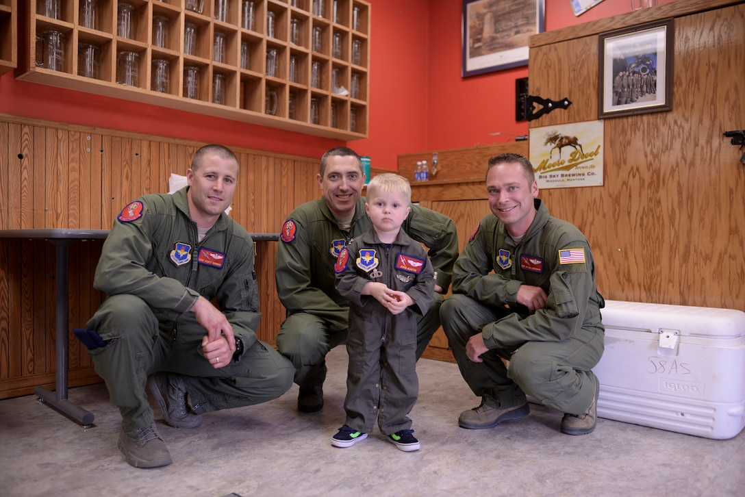 Two-year-old John Austin stands with members of the 58th Airlift Squadron May 15, 2014, at Altus Air Force Base, Oklahoma. Master Sgt. Keith Hackney of the 58th AS coordinated with other squadrons on base to make John's day full of excitement and adventure. (U.S. Air Force photo/Staff Sgt. Nathanael Callon)
