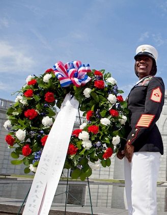 Sgt. Major Lanette Wright, the 24th Marine Expeditionary Unit sergeant major, was recognized by the Congressional Caucus for Woman's Issues during their military wreath laying ceremony at the Woman in Military Service for America Memorial in Arlington, Virginia, May 20, 2014. The ceremony was held in honor of military service women.