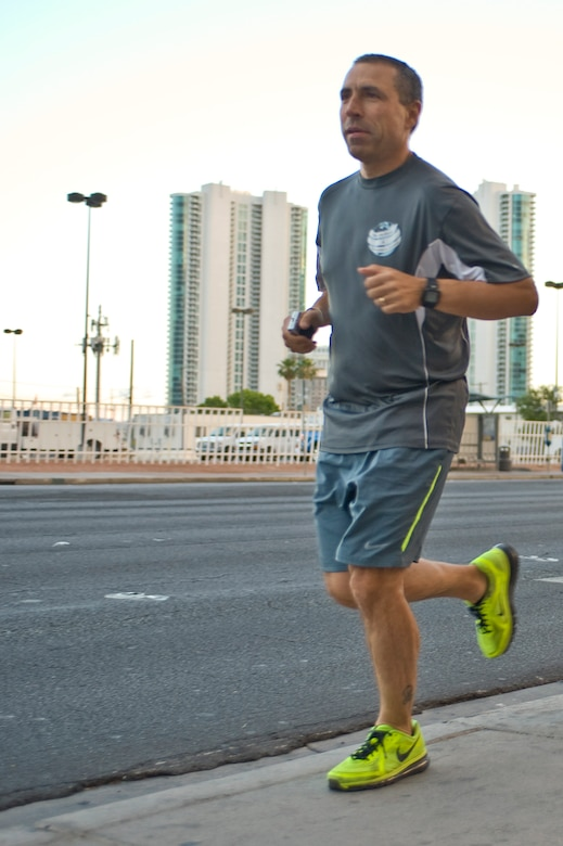 Col. Marcus Cranston starts a four mile run May 7, 2014, in Las Vegas. Cranston ran four miles in 44 countries in four weeks that raised awareness for Parkinson's disease that began April 4, 2014. Cranston's first run began in Mongolia and his last run ended in Las Vegas. Cranston is the 99th Medical Group director of medical education endocrinology and preventive medicine,  (U.S. Air Force photo by Senior Airman Christopher Tam)