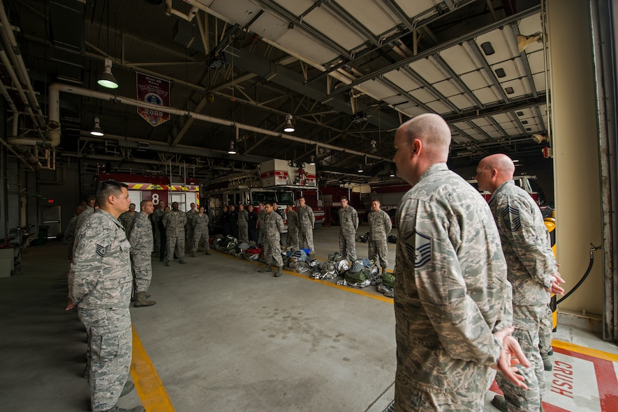 The 51st Civil Engineer Squadron Firefighters stand in formation for shift change May 20, 2014, at Osan Air Base, Republic of Korea. The department primarily runs on two 24-hour shifts, and is responsible for responding to a variety of emergency calls on base. (U.S. Air Force photo by Staff Sgt. Jake Barreiro)