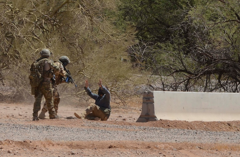 A Combat Search and Rescue team capture an opposition force member at training site during a training mission in Exercise ANGEL THUNDER on May 16, 2014 at the Florence Military Reservation, Ariz. ANGEL THUNDER 2014 is the largest and most realistic joint service, multinational, interagency combat search and rescue exercise designed to provide training for personnel recovery assets using a variety of scenarios to simulate deployment conditions and contingencies. Personnel recovery forces will train through the full spectrum of personnel recovery capabilities with ground recovery personnel, air assets, and interagency teams. (U.S. Air Force photo by Staff Sgt. Adam Grant/Released)