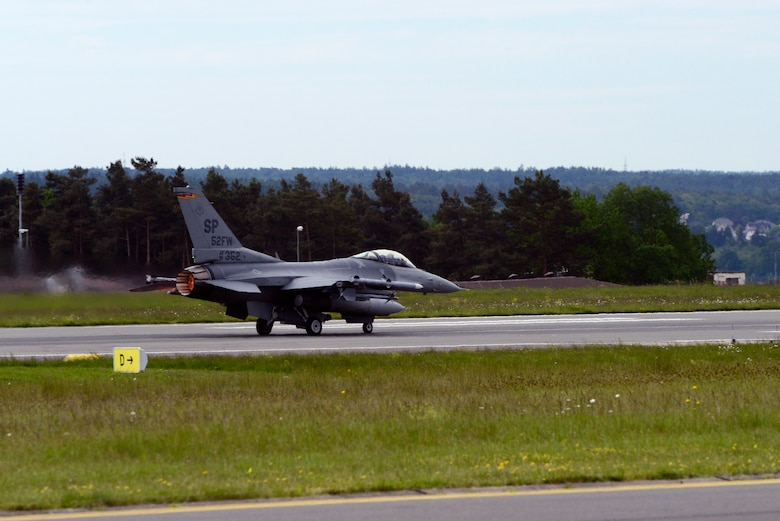U.S. Air Force Col. David Julazadeh, 52nd Fighter Wing commander, pilots a U.S. Air Force F-16 Fighting Falcon fighter aircraft during take-off for his final flight as a saber, May, 20, 2014, at Spangdahlem Air Base, Germany. This flight is an Air Force tradition commemorating the departure of a commander or accompanying a milestone in the career of an entire aircrew. (U.S. Air Force photo by Staff Sgt. Christopher Ruano/Released)