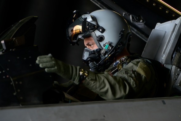 U.S. Air Force Col. David Julazadeh, 52nd Fighter Wing commander, prepares for his final flight in a U.S. Air Force F-16 Fighting Falcon fighter aircraft May, 20, 2014, at Spangdahlem Air Base, Germany. This flight is an Air Force tradition commemorating the departure of a commander or accompanying a milestone in the career of an entire aircrew. (U.S. Air Force photo by Staff Sgt. Christopher Ruano/Released)
