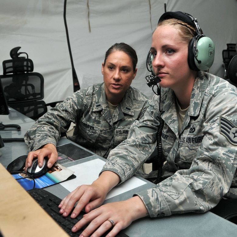 Air Battle Manager 1st Lt. Kristina Roberts and Surveillance Technician Staff Sgt. Lindsey Wagner monitor air traffic while serving with the 727th Expeditionary Air Control Squadron at an undisclosed location in Southwest Asia on May 9, 2014. The Air National Guard personnel were preparing to complete their deployment to the 380th Air Expeditionary Wing and redeploy home. (U.S. Air Force photo by Senior Master Sgt. Eric Peterson/Released)
