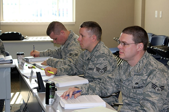 Senior Airmen Dylan Barriger, Andrew Farrell and Mark Welch listen in during an Airmen Leadership School satellite class at Selfridge Air National Guard Base, Mich., May 17, 2017. ALS is a required level of professional military education for an Airman to be eligible for promotion to staff sergeant. (U.S. Air National Guard photo by Technical Sgt. Dan Heaton)