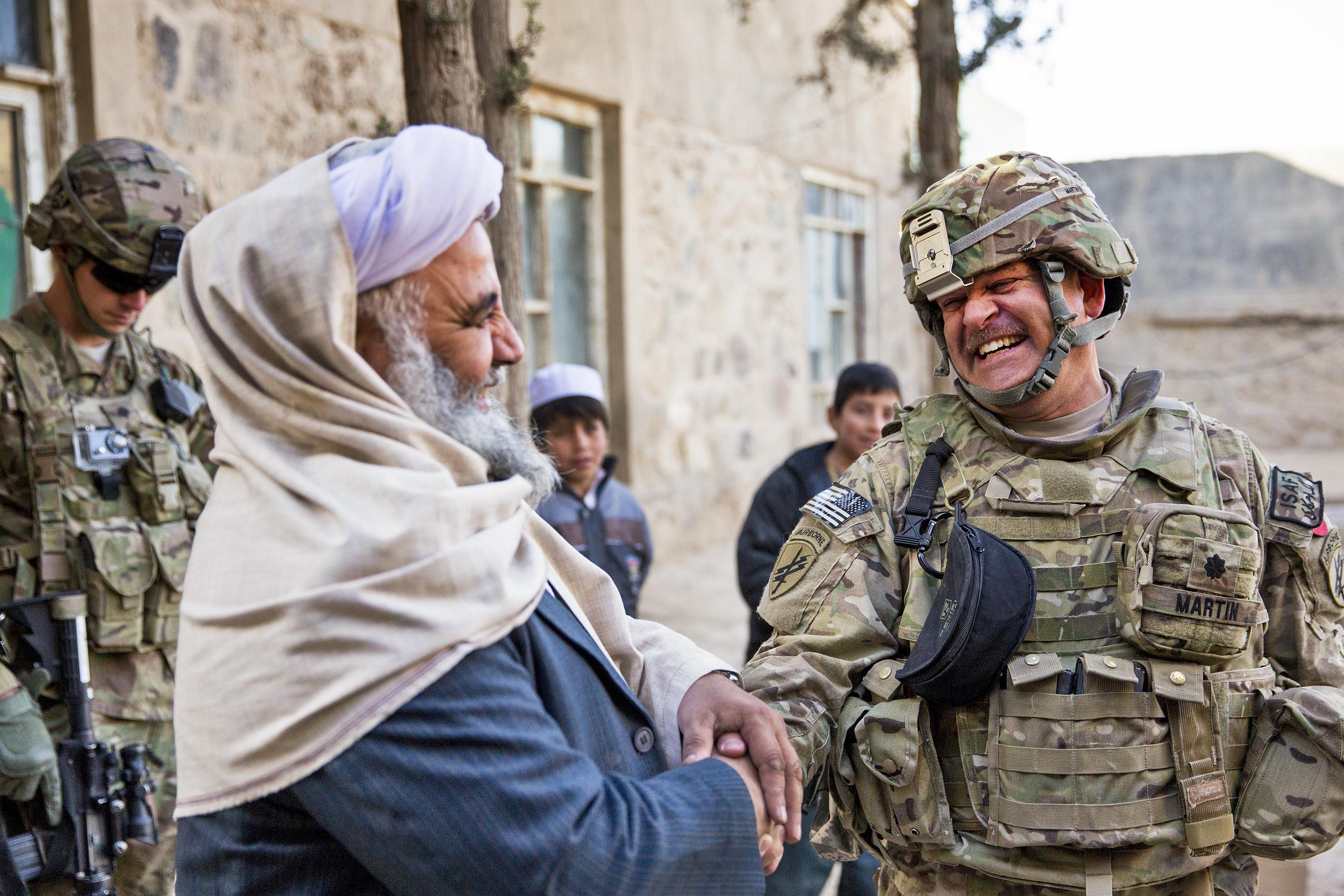 Image result for us soldier afghan handshake