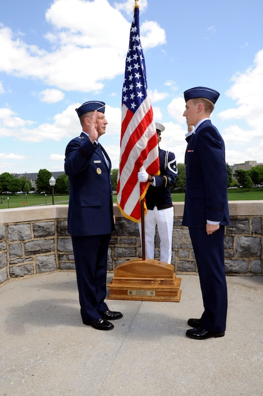 Maj. Gen. John Dolan gives the Oath of Commissioned Officers to his son, 2nd Lt. Joe Dolan, during a commissioning ceremony May 16, 2014, at Virginia Tech University in Blacksburg, Va. Joe was named distinguished graduate and will attend training to become a remotely-piloted aircraft pilot. John is the assistant deputy commander for U.S. Air Forces Central Command and assistant vice commander for the 9th Air Expeditionary Task Force. (U.S. Air Force photo/Staff Sgt. Katherine Holt)