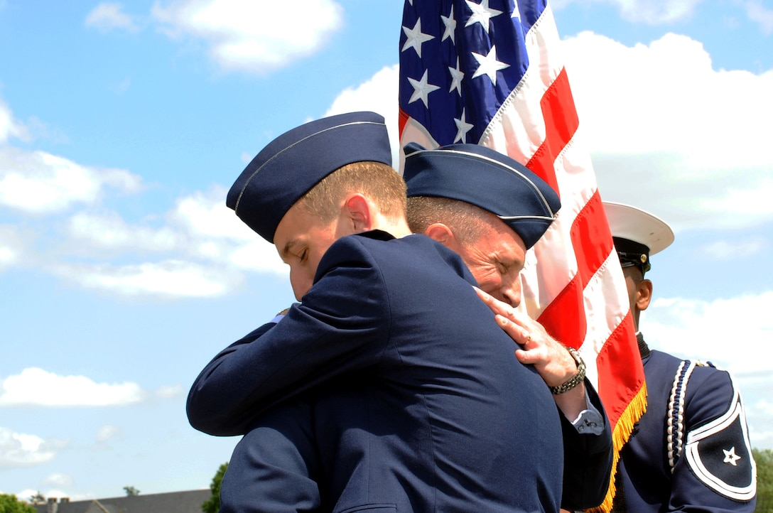 Maj. Gen. John Dolan embraces his son, 2nd Lt. Joe Dolan, during a commissioning ceremony May 16, 2014, at Virginia Tech University in Blacksburg, Va. Joe was named distinguished graduate and will attend training to become a remotely-piloted aircraft pilot. John is the assistant deputy commander for U.S. Air Forces Central Command and assistant vice commander for the 9th Air Expeditionary Task Force. (U.S. Air Force photo/Staff Sgt. Katherine Holt)