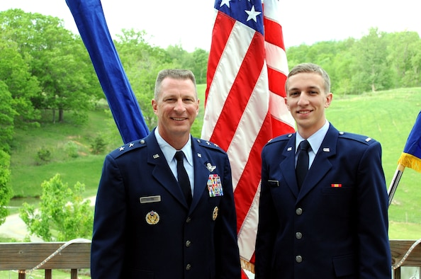 Maj. Gen. John Dolan poses with his son, 2nd Lt. Joe Dolan, after a promotion ceremony May 17, 2014, in Blacksburg, Va. John is the assistant deputy commander for U.S. Air Forces Central Command and assistant vice commander for the 9th Air Expeditionary Task Force. (U.S. Air Force photo/Staff Sgt. Katherine Holt)
