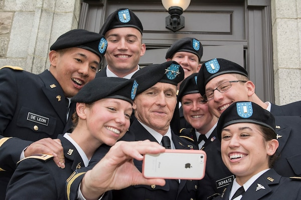 Newly commissioned second lieutenants, formerly cadets in the University of Rhode Island's Army ROTC battalion, take a selfie with DIA Director Lt. Gen. Michael Flynn after a commissioning ceremony May 16.