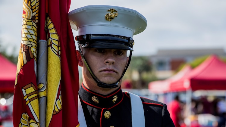 Corporal Justin G. Rush, embarkation specialist, 15th Marine Expeditionary Unit, mentally prepares to present the Colors during a commencement ceremony at Palomar College campus in San Marcos, Calif., May 20, 2014. Rush, 20, is from Tacoma, Wash. (U.S. Marine Corps photo by Lance Cpl. Anna Albrecht/Released)