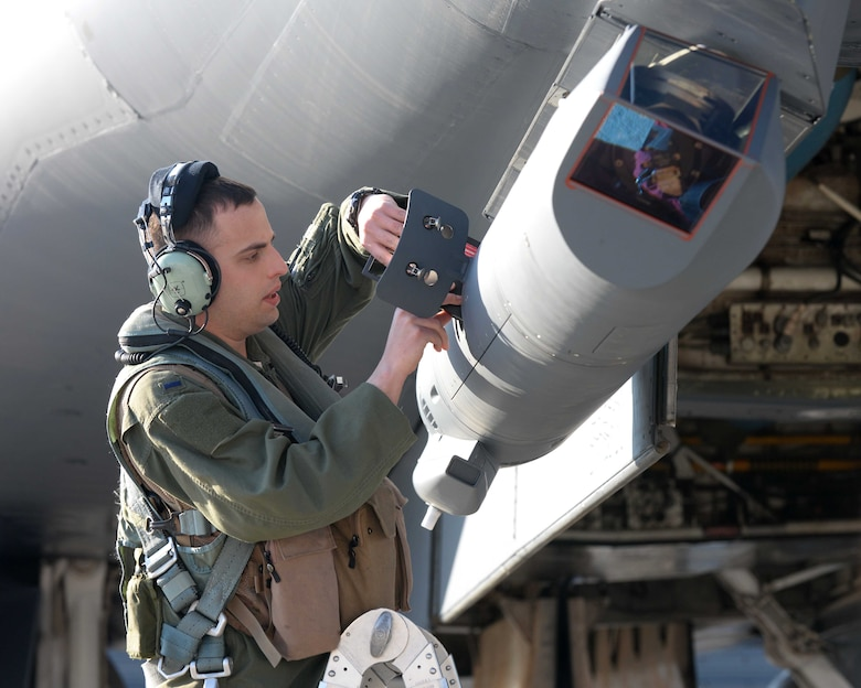 First Lt. Brian Combes, 34th Bomb Squadron B-1 offensive systems officer, loads software into a sniper advanced targeting pod on a B-1B Lancer prior to a Global Power Mission at Ellsworth Air Force Base, S.D., May 12, 2014. The long-range targeting system provides aircrews with positive target identification, autonomous tracking coordinate generation and precise weapons guidance from extended standoff ranges supporting air to ground operations.(U.S. Air Force photo by Airman 1st Class Rebecca Imwalle/Released)