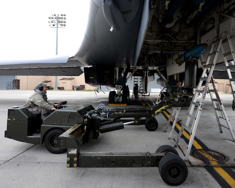 Airman Sidney Hering, 28th Aircraft Maintenance Squadron weapons load crewmember, uses a ram jammer to load an inert 500-pound training munition in preparation for a Global Power Mission  from Ellsworth Air Force Base, S.D., May 12, 2014. During the mission, B-1 aircrews flew 13,200 miles round trip and employed munitions accurately within a 5 meter target area on a training range near Guam. (U.S. Air Force photo by Airman 1st Class Rebecca Imwalle/Released)
