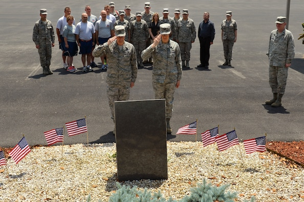 MCGHEE TYSON AIR NATIONAL GUARD BASE, Tenn. - The I.G. Brown Training and Education Center Commander, Col. Tim Cathcart, left, and incoming commander, Col. Jessica Meyeraan, render their salutes during a ceremony that honored the TEC's Academy of Military Science and the Enlisted Professional Military Education graduates who died in service to the nation. (U.S. Air National Guard photo by Master Sgt. Kurt Skoglund/Released)