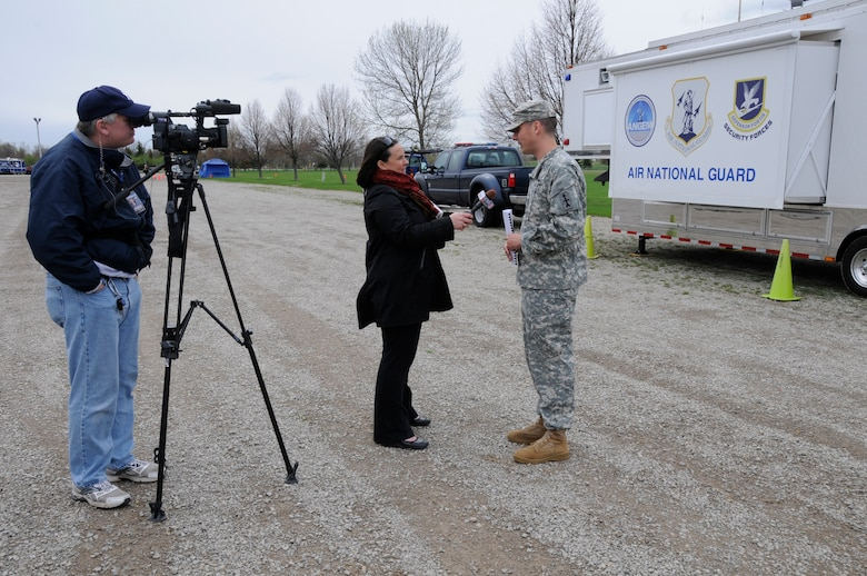 Army Capt. Chris Robbins, Officer in Charge, Wisconsin National Guard Joint Operations Center, is interviewed by Emily Matesic, a reporter from WBAY-TV during SIMCOM 2014 at Sunnyview Expo Center in Oshkosh, Wis. May 15, 2014. SIMCOM (State Interoperable Mobile Communications) is a functional exercise designed to test the interoperability of federal, state, county, tribal, volunteer, private organizations and defense communications and data sharing. Air National Guard photo by Tech. Sgt. Todd Pendleton (Released)