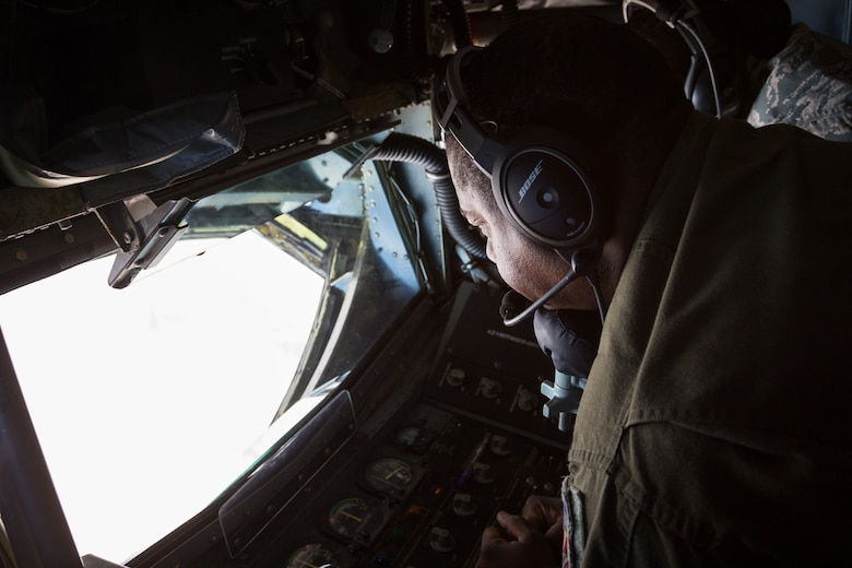 What does your office view look like? With his head positioned on a chin rest and hands on the boom flight control stick and other controls, Master Sgt. Vincent Jones, a boom operator based out of the 161st Air Refueling Wing in Phoenix, Ariz., makes sure that contact is made between receiver and boom. (U.S. Air National Guard photo by Tech. Sgt. Hampton Stramler/Released)