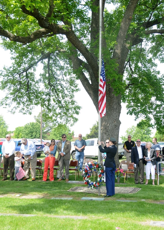 Family members of 2nd Lt. George A. Whiteman look on as Sedalia Smith-Cotton High-School Junior Reserve Officer Training Corps Cadet Megan Wilbanks prepares to lower the flag during the Armed Forces Day ceremony in Sedalia, Missouri., May 17, 2014. More than 50 family members of Whiteman attended the ceremony, carrying on a tradition that began 26 years ago. (U.S. Air National Guard photo by Senior Airman Nathan Dampf/Released)