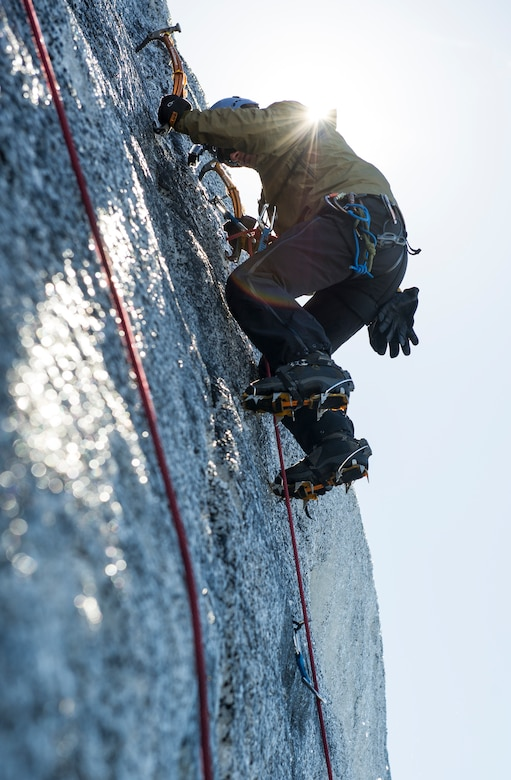 KEFLAVIK, Iceland -- Tech. Sgt. Daniel, 48th Air Expeditionary Group pararescueman, ice climbs up the side of a glacier during training near Keflavik, Iceland, May 18, 2014. Although the Airmen's primary objective is to rescue downed aircrew deployed with the 48th Air Expeditionary Group for Icelandic Air Policing if needed, the trip provides an opportunity to accomplish training objectives the team wouldn't ordinarily have access to near Kadena Air Base, Japan, from where they are deployed. (U.S. Air Force photo/Tech. Sgt. Benjamin Wilson) (Released)