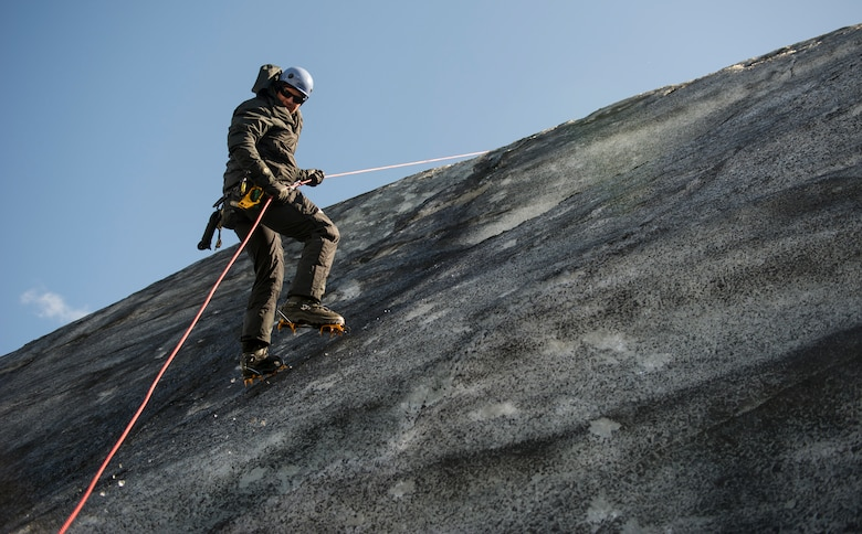 KEFLAVIK, Iceland -- Senior Airman Dylan, 48th Air Expeditionary Group pararescueman, rappels down the side of a glacier during training near Keflavik, Iceland, May 18, 2014. Although the Airmen's primary objective is to rescue downed aircrew deployed with the 48th Air Expeditionary Group for Icelandic Air Policing if needed, the trip provides an opportunity to accomplish training objectives the team wouldn't ordinarily have access to near Kadena Air Base, Japan, from where they are deployed. (U.S. Air Force photo/Tech. Sgt. Benjamin Wilson) (Released)
