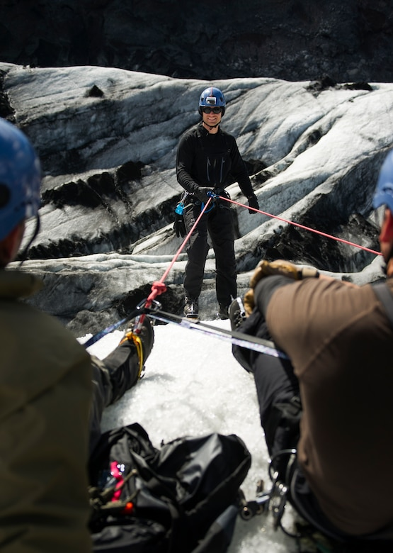 KEFLAVIK, Iceland -- Staff Sgt. Brian, 48th Air Expeditionary Group pararescueman, rappels down the side of a glacier during training near Keflavik, Iceland, May 18, 2014. Although the Airmen's primary objective is to rescue downed aircrew deployed with the 48th Air Expeditionary Group for Icelandic Air Policing if needed, the trip provides an opportunity to accomplish training objectives the team wouldn't ordinarily have access to near Kadena Air Base, Japan, from where they are deployed. (U.S. Air Force photo/Tech. Sgt. Benjamin Wilson) (Released)