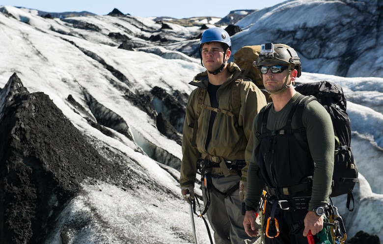 KEFLAVIK, Iceland -- Capt. Paul (left), 48th Air Expeditionary Group combat rescue officer, and Senior Master Sgt. Caleb, 48th AEG pararescueman, look out over a glacier during training near Keflavik, Iceland, May 18, 2014. The Airmen are deployed for Icelandic Air Policing to rescue downed aircrew deployed with the 48th Air Expeditionary Group if needed, but the trip provides an opportunity to accomplish training objectives the team wouldn't ordinarily have access to near Kadena Air Base, Japan, from where they are deployed. (U.S. Air Force photo/Tech. Sgt. Benjamin Wilson) (Released)