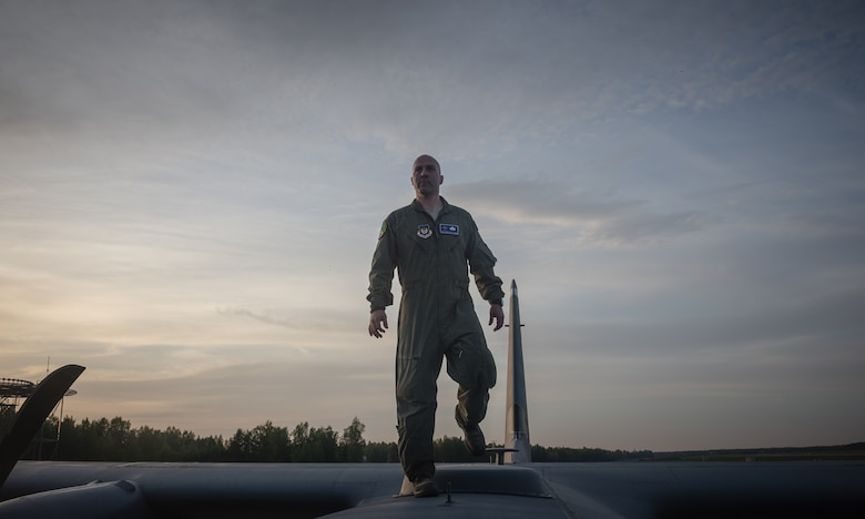 Tech. Sgt. Francis Gilson, 86th Aircraft Maintenance Squadron flying crew chief, an Andersonville, Tennesse native, prepares to climb inside a 37th Airlift Squadron C-130J Super Hercules after post-flight checks on Riga International Airport, Latvia, May 17, 2014. Gilson was part of a five-man crew including 37th AS pilots and loadmasters. The team spent four days across three Baltic countries assisting in personnel drops of allied partners and American service members. (U.S. Air Force photo/Airman 1st Class Jordan Castelan)