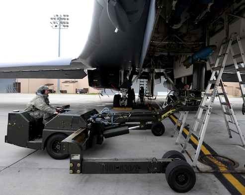 Airman Sidney Hering, 28th Aircraft Maintenance Squadron weapons load crewmember, uses a ram jammer to load an inert 500-pound training munition in preparation for a Global Power Mission from Ellsworth Air Force Base, S.D., May 12, 2014. During the mission, B-1 aircrews flew 13,200 miles round trip and employed munitions accurately within a 5 meter target area on a training range near Guam. (U.S. Air Force photo by Airman 1st Class Rebecca Imwalle)