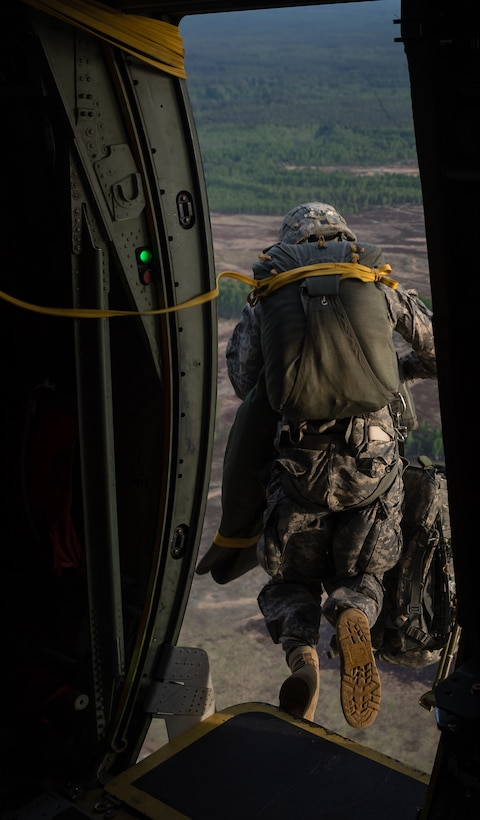 A U.S. Army paratrooper jumps from a 37th Airlift Squadron C-130J Super Hercules over Lithuania, May 17, 2014. Pilots and loadmasters from the 37th AS, alongside an 86th Aircraft Maintenance flying crew chief spent four days across three Baltic countries assisting in personnel drops of allied partners and American service members. (U.S. Air Force photo/Airman 1st Class Jordan Castelan)