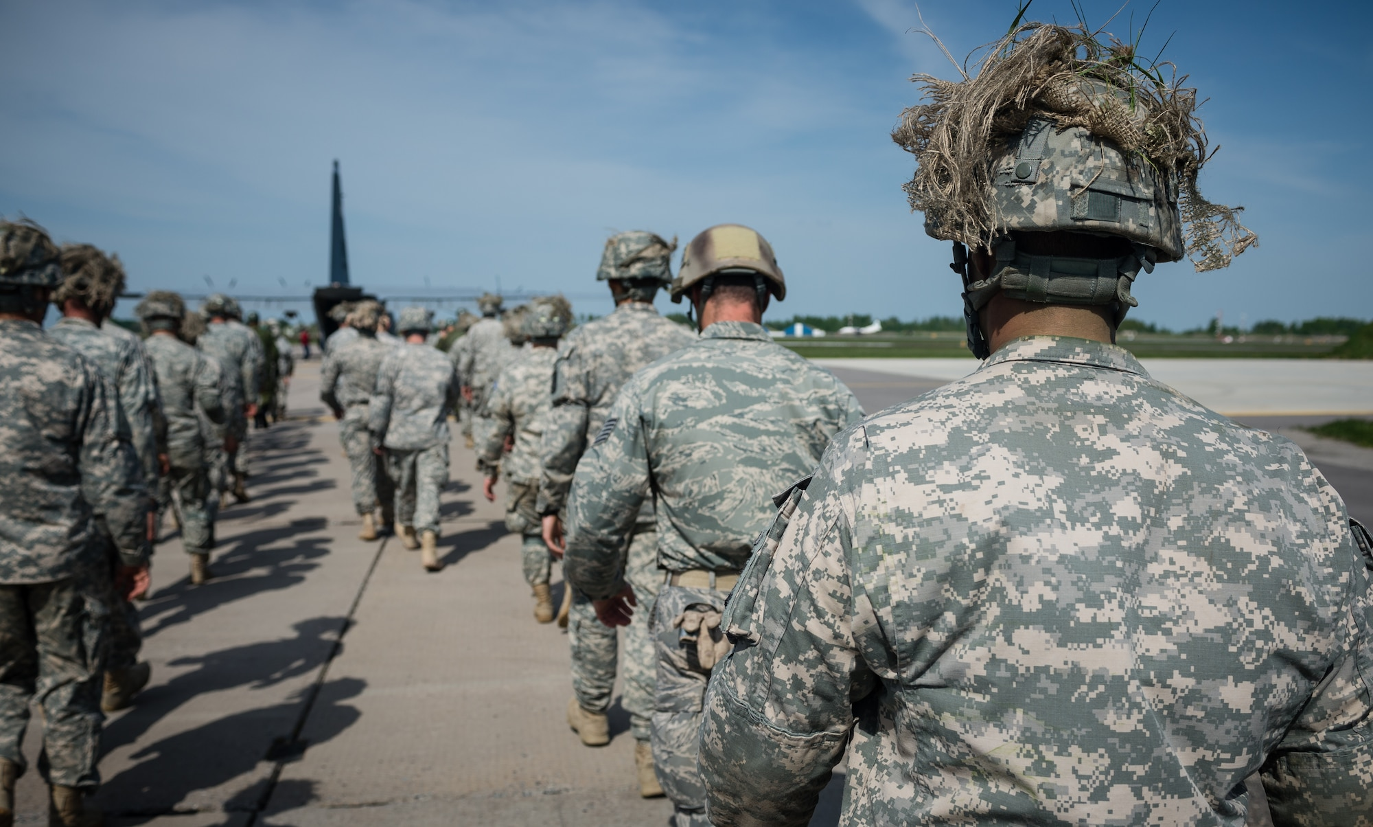 U.S. Airmen and Soldiers prepare to board a 37th Airlift Squadron C-130J Super Hercules alongside Lithuanian paratroopers at Šiauliai International Airport, Lithuania, May 17, 2014. Pilots and loadmasters from the 37th AS alongside an 86th Aircraft Maintenance Squadron crew chief spent four days across three Baltic countries assisting in personnel drops of allied partners and American service members. (U.S. Air Force photo/Airman 1st Class Jordan Castelan)