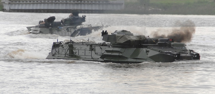 Two assault amphibious vehicles travel in Marine Corps Support Facility Blount Island's slipway adjacent to the St. John's River, Jacksonville, Fla., May 15, after successfully completing their launch from the U.S. Naval Ship Pfc. Dewayne T. Williams.