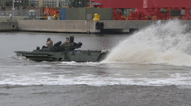 An assault amphibious vehicle churns up Marine Corps Support Facility Blount Island's slipway of the St. John's River, Jacksonville, Fla., May 15, marking the first time in several years tracks have splashed from a Maritime Prepositioning Force ship.