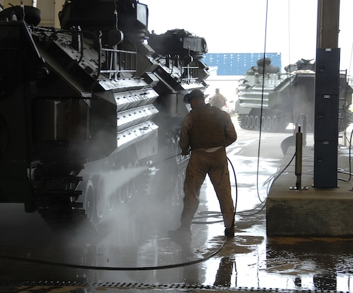 A Marine washes an assault amphibious vehicle after testing its operational capabilities in Marine Corps Support Facility Blount Island's slipway adjacent to the St. John's River, Jacksonville, Fla., May 15.