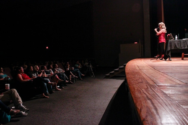 Mollie Gross, comedienne and motivational speaker, performs for spouses at the Lasseter Theatre aboard Marine Corps Air Station Beaufort, May 16. Mollie Gross has been performing as a comedienne since 2008, and also holds motivational workshops for spouses.