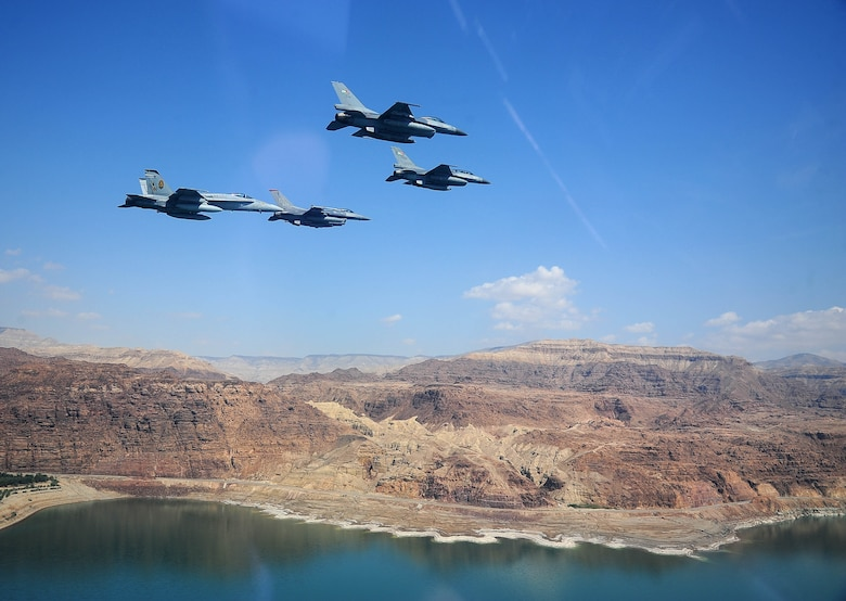 F-16 Fighting Falcons from the U.S. and Royal Jordanian air forces, as well as an F-18 Hornet from the U.S. Marine Corps, fly in formation during Exercise Eager Tiger May 13, 2014, over the Dead Sea in Jordan. Hosted annually in Jordan, the exercise allows fighter pilots and maintainers from around the world to exchange knowledge while increasing interoperability and showing their dedication to regional stability. (U.S. Air Force photo/Staff Sgt. Roidan Carlson)