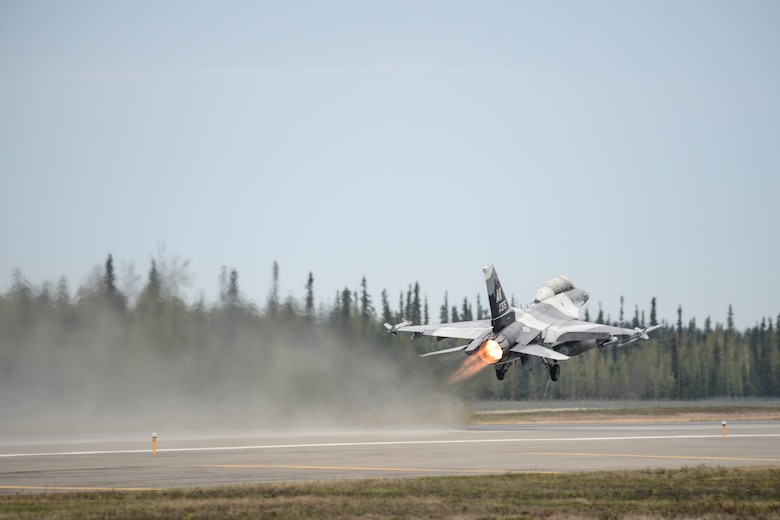 An F-16 Fighting Falcon assigned to the 18th Aggressor Squadron takes off during Red Flag Alaska 14, May 13, 2014, at Eielson Air Force Base, Alaska. The 18th AGRS tests visiting units' combat capability by acting as an enemy force throughout the exercise. (U.S. Air Force photo/Senior Airman Peter Reft)