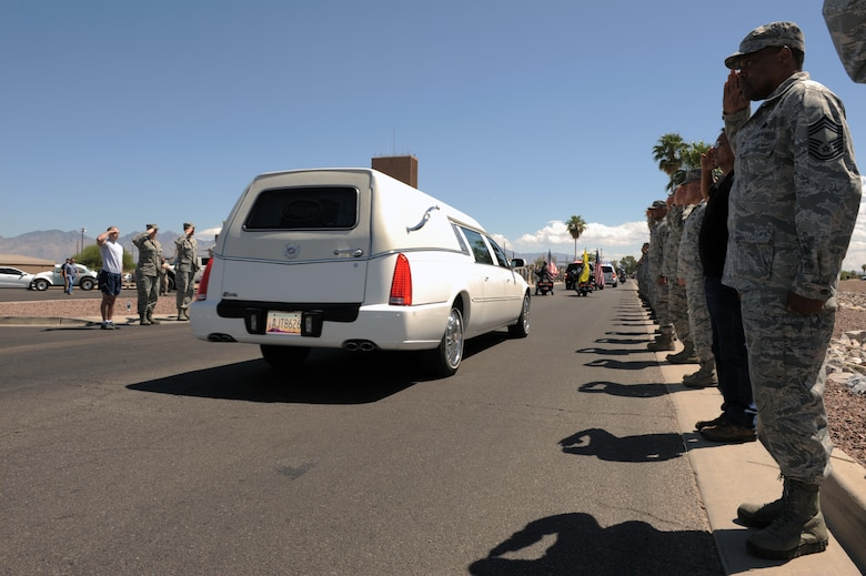 Desert Lightning Team members render a salute as the procession of U.S. Army Command Sgt. Maj. Martin Barreras' passes by them at Davis-Monthan Air Force Base, Ariz., May 22, 2014. Barreras, a native of Tucson, Ariz., died May 13, in San Antonio Military Medical Center, Joint Base San Antonio, Texas, from wounds suffered on May 6, in Harat Province, Afghanistan, when enemy forces attacked his unit with small arms fire. (U.S. Air Force photo by Airman 1st Class Chris Drzazgowski/Released)
