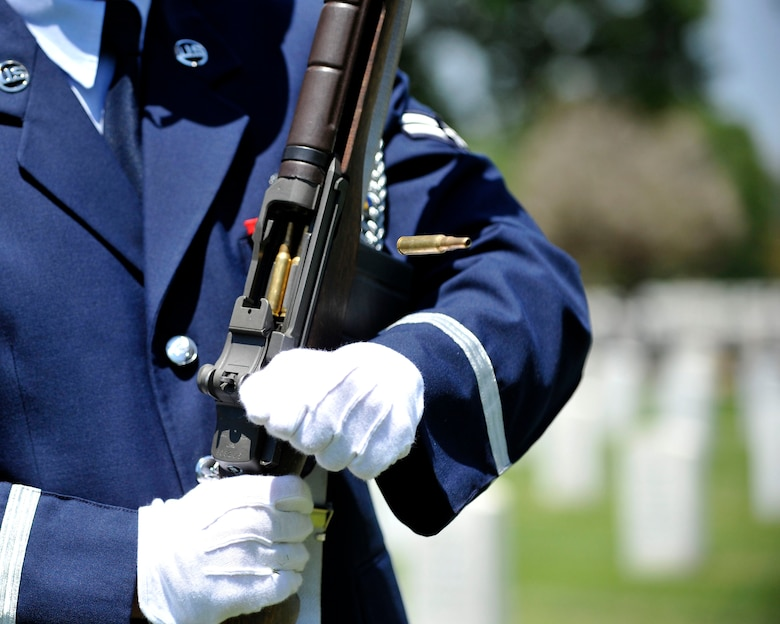 A U.S. Air Force Mile High Honor Guard Airmen charges his ceremonial rifle during a three volley salute July 11, 2012, at Fort Logan National Cemetery in Denver. The base honor guard performs final military honors at nearly 570 funerals per year and is the face of the United States Air Force to many families who have lost their loved ones. (U.S. Air Force photo by Tech. Sgt. Wolfram Stumpf/Released)