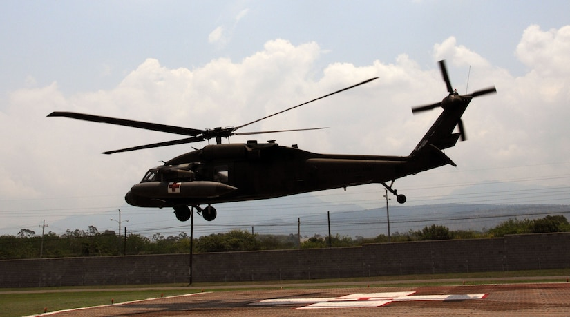 A U. S. Army UH-60 Blackhawk MEDEVAC helicopter takes off from the Joint Task Force- Bravo Medical Element's helicopter pad at Soto Cano Air Base to transport an automobile accident victim to the Hospital Militar in Tegucigalpa, Honduras, May 13, 2014, in response to a Honduran government request for a medical evacuation (MEDEVAC).  A vehicle traveling west on Honduras Highway CA-5 about 13 miles outside of Comayagua was struck from behind by a tractor trailer truck.  The 18-wheeler subsequently pushed the vehicle into the trailer of another tractor trailer crushing the vehicle.  (Photo by U. S. Air National Guard Capt. Steven Stubbs)