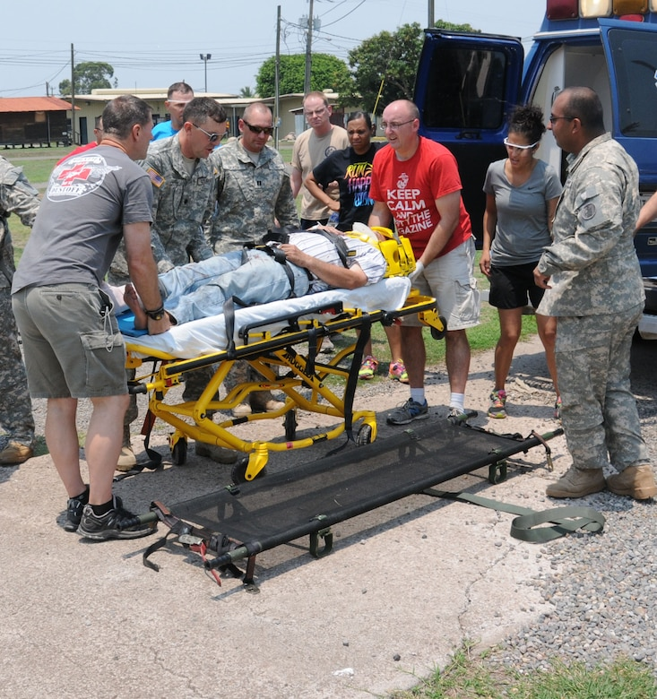 Personnel from Joint Task Force-Bravo's Medical Element (MEDEL) remove an automobile accident patient from an ambulance to prepare him for an air medical evacuation (MEDEVAC) to Hospital Militar in Tegucigalpa, Honduras, May 13, 2014.  Joint Task Force-Bravo's Medical Element (MEDEL) and 1-228th Aviation Regiment responded to a Honduran government request for a ground and air medical evacuation (MEDEVAC).  A vehicle traveling west on Honduras Highway CA-5 about 13 miles outside of Comayagua was struck from behind by a tractor trailer truck.  The 18-wheeler subsequently pushed the vehicle into the trailer of another tractor trailer crushing the vehicle.  (Photo by U. S. Air National Guard Capt. Steven Stubbs)