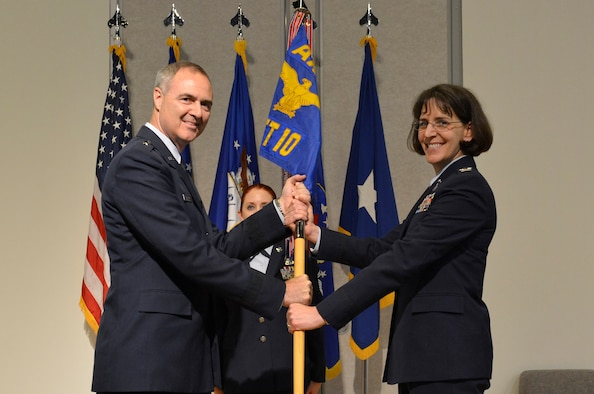 MCGHEE TYSON AIR NATIONAL GUARD BASE, Tenn. - Col. Jessica Meyeraan, right, accepts the guidon of the I.G. Brown Training and Education Center from the Air National Guard Readiness Center's commander, Brig. Gen. R. Scott Williams, during a change-of-command ceremony held in Spruance Hall on May 22, 2014. The formal ceremony signals the official transfer of power from the previous commander, Col. Tim Cathcart, to Meyeraan. (U.S. Air National Guard photo by Master Sgt. Kurt Skoglund/Released)