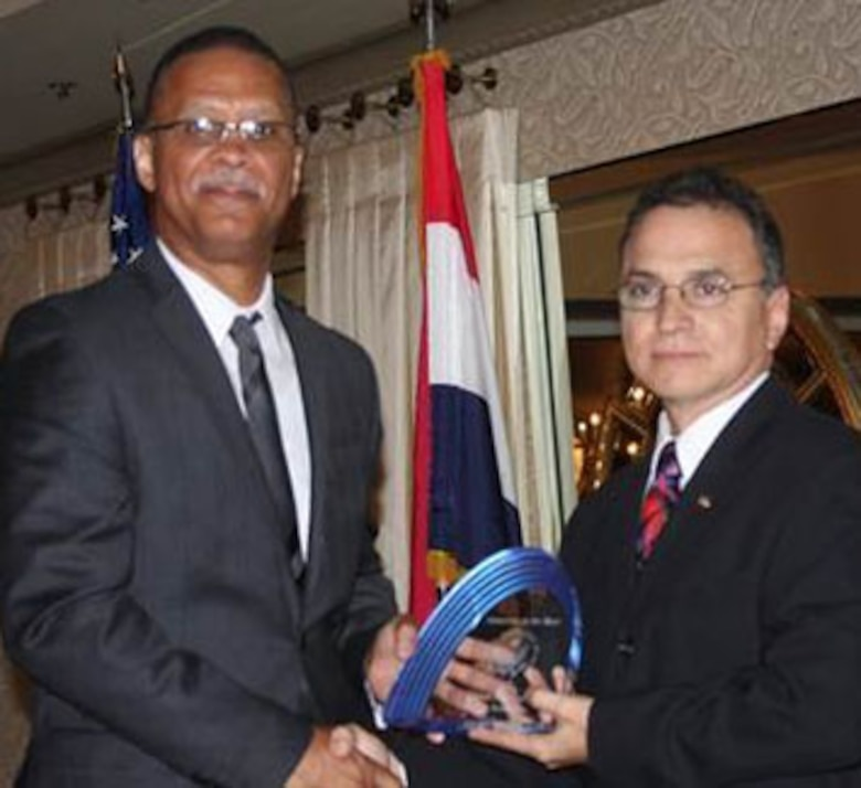 SCOTT AIR FORCE BASE, Ill. – Ed Martinez, Information Security Specialist for the Air Force Network Integration Center, accepts the Community Service individual category award from Mark McKinley, Greater St. Louis Federal Executive Board chair, on May 8. (Courtesy Photo)