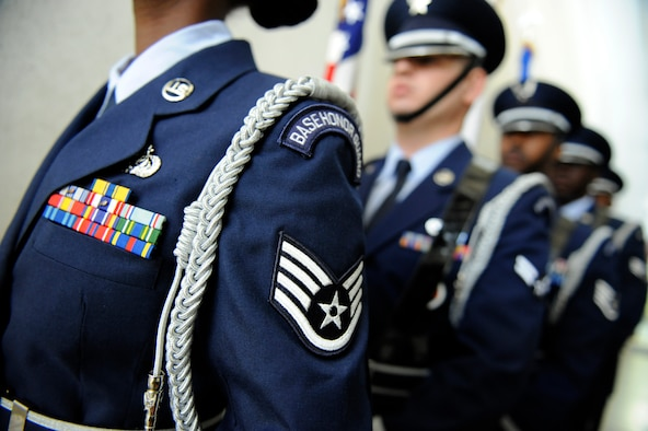 Members of the Kadena Air Base Honor Guard prepare to present the U.S., Japanese and Air Force flags during a retirement ceremony on Kadena Air Base, Japan, May 16, 2014. The honor guard is an all-volunteer duty that allows Airmen to show dignity and respect to service members and the nation. (U.S. Air Force photo by Senior Airman Maeson L. Elleman)